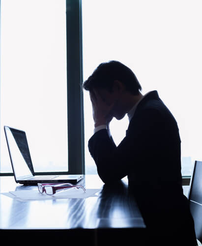 image of a stressed out office worker